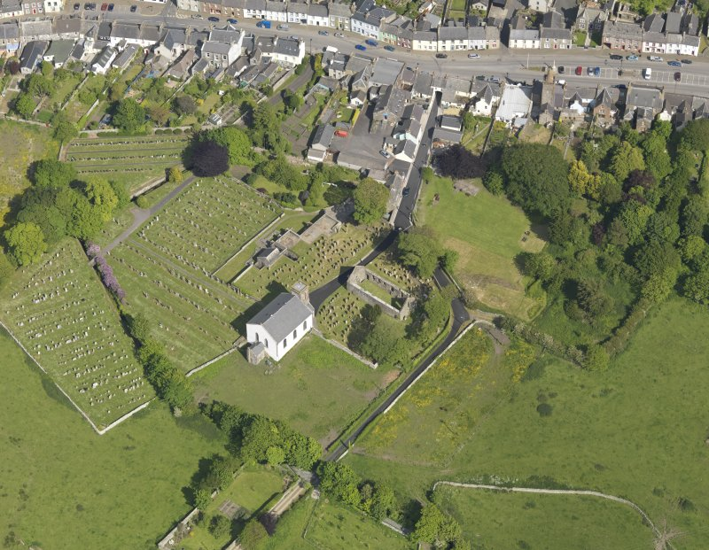 Oblique aerial view of Whithorn Parish Church and priory, taken from the W.