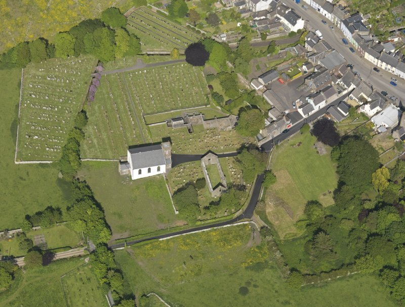 Oblique aerial view of Whithorn Parish Church and priory, taken from the SW.
