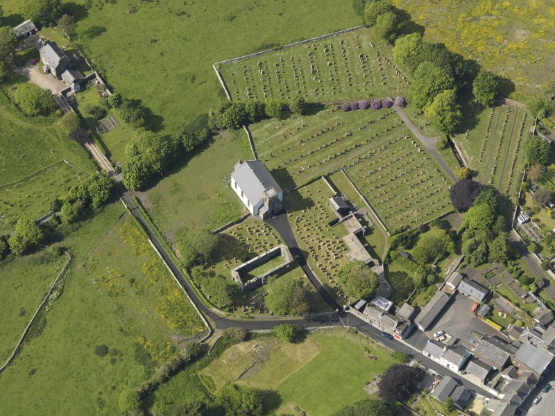 Oblique aerial view of Whithorn Parish Church and priory, taken from the SSE.