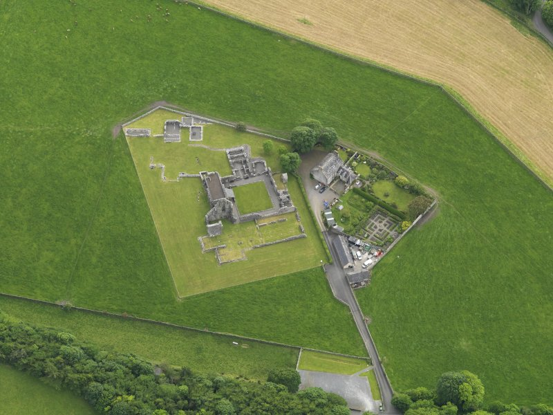 Oblique aerial view of Glenluce Abbey, taken from the NE.