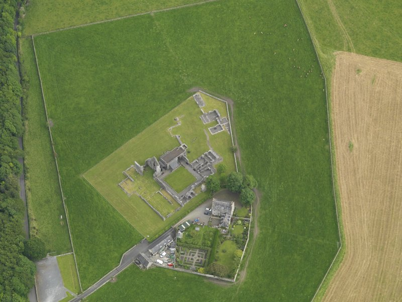 Oblique aerial view of Glenluce Abbey, taken from the NNW.