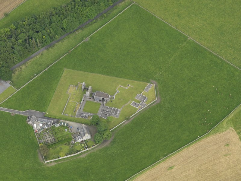 Oblique aerial view of Glenluce Abbey, taken from the WNW.