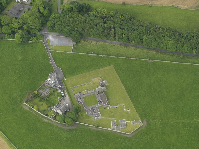 Oblique aerial view of Glenluce Abbey, taken from the SW.