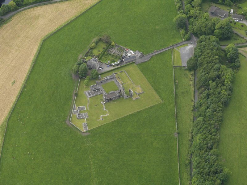 Oblique aerial view of Glenluce Abbey, taken from the SE.