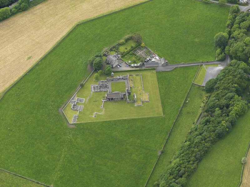 Oblique aerial view of Glenluce Abbey, taken from the ESE.