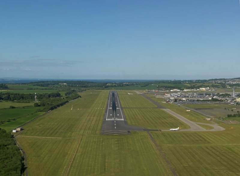 Oblique aerial view looking along the runway at Edinburgh airport on approach for landing, taken from the WSW.