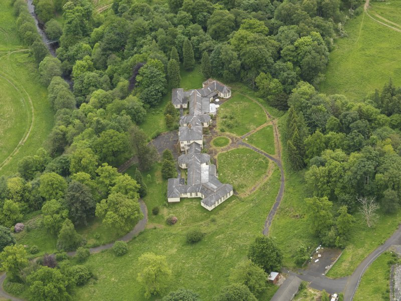 Oblique aerial view of Birkwood House and policies, taken from the NW.