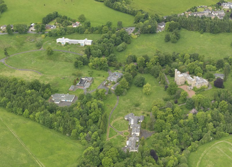 Oblique aerial view of Birkwood House and policies, taken from the SE.