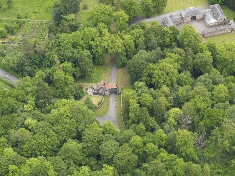 Oblique aerial view of Sorn Castle upper gate lodge and stables, taken from the NW.