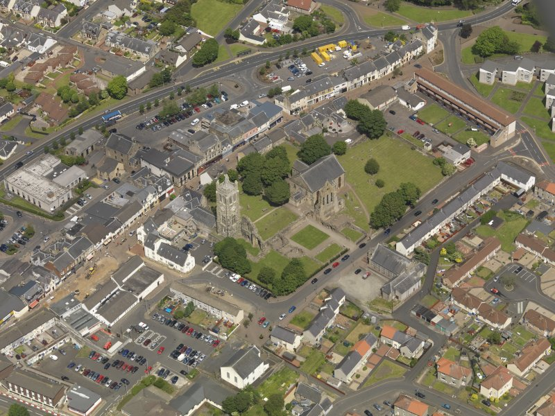 General oblique aerial view of Kilwinning Abbey, taken from the SSW.