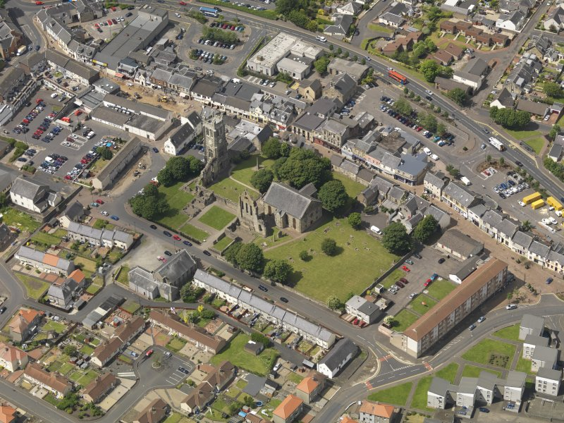 General oblique aerial view of Kilwinning Abbey, taken from the SE.