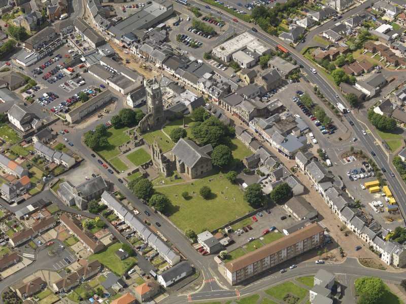 General oblique aerial view of Kilwinning Abbey, taken from the ESE.