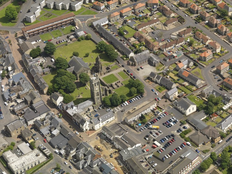 General oblique aerial view of Kilwinning Abbey, taken from the WNW.