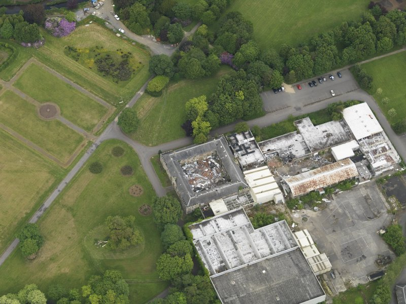 Oblique aerial view of Eglinton Country Park stables, taken from the SW.