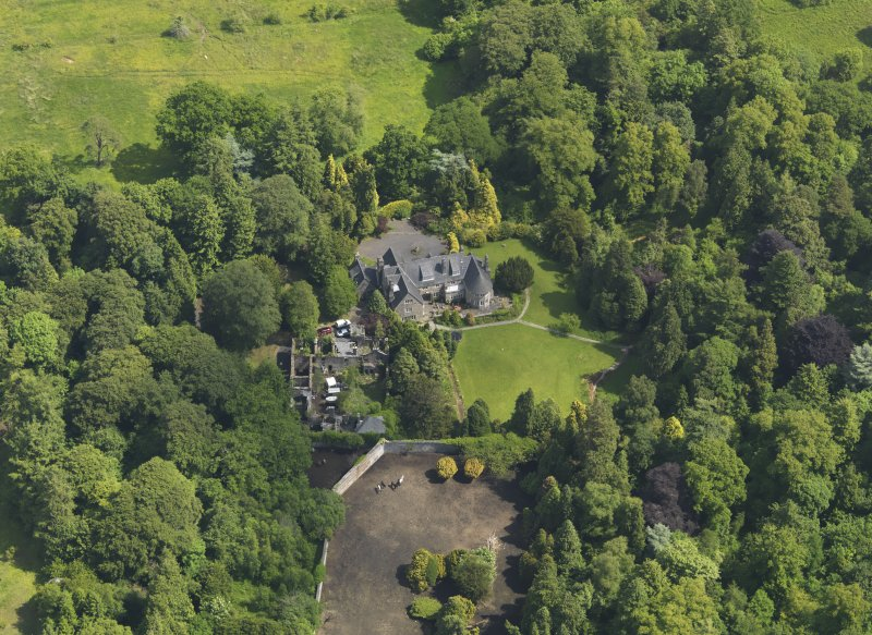 Oblique aerial view of Treesbank House and stables, taken from the W.