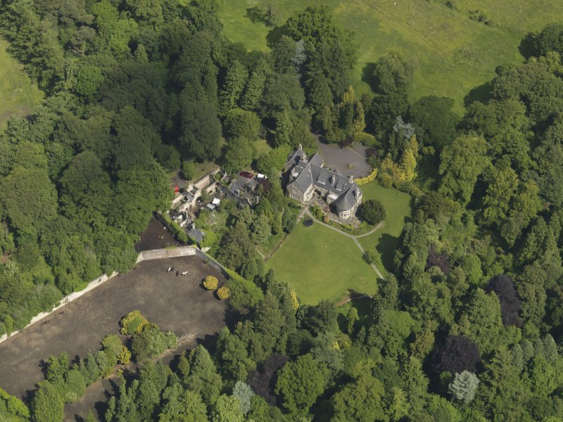 Oblique aerial view of Treesbank House and stables, taken from the SW.