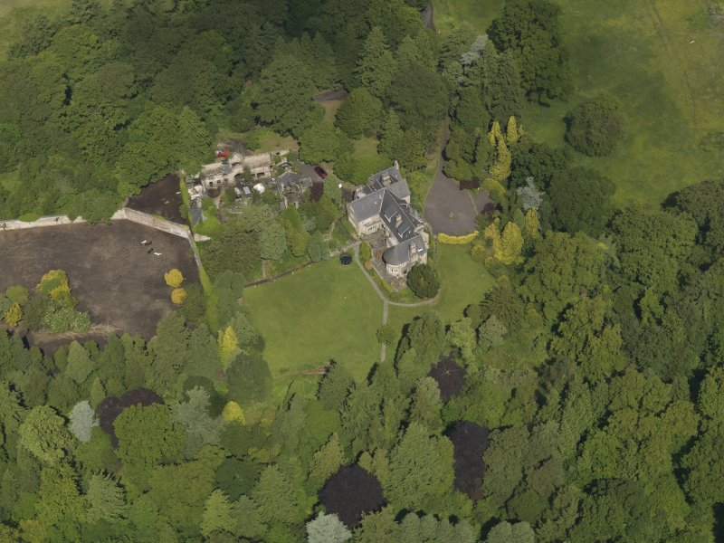 Oblique aerial view of Treesbank House and stables, taken from the S.