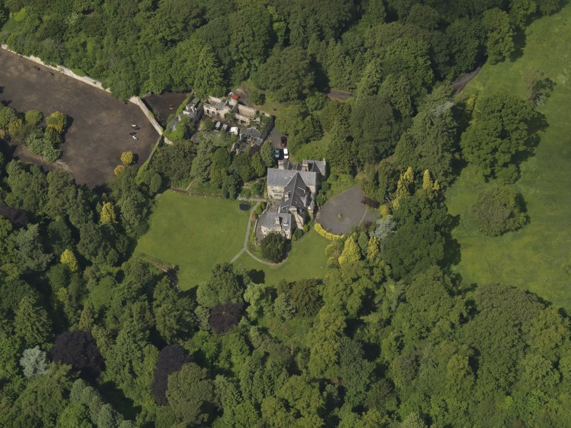 Oblique aerial view of Treesbank House and stables, taken from the SE.