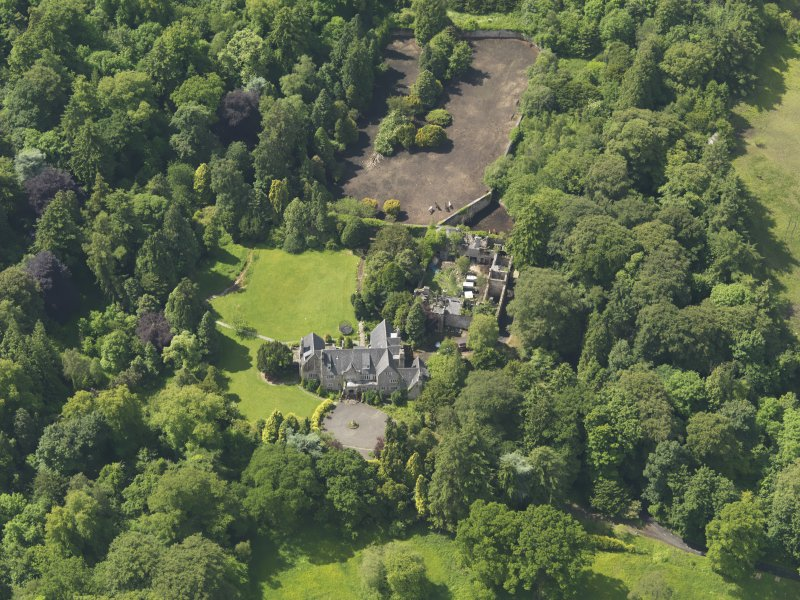 Oblique aerial view of Treesbank House and stables, taken from the NNE.