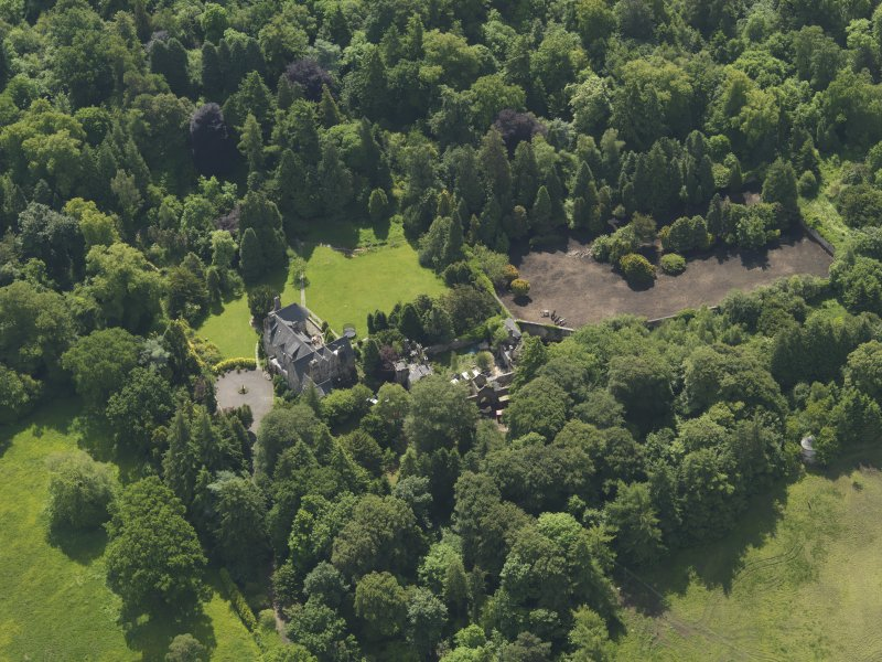 Oblique aerial view of Treesbank House and stables, taken from the NNW.