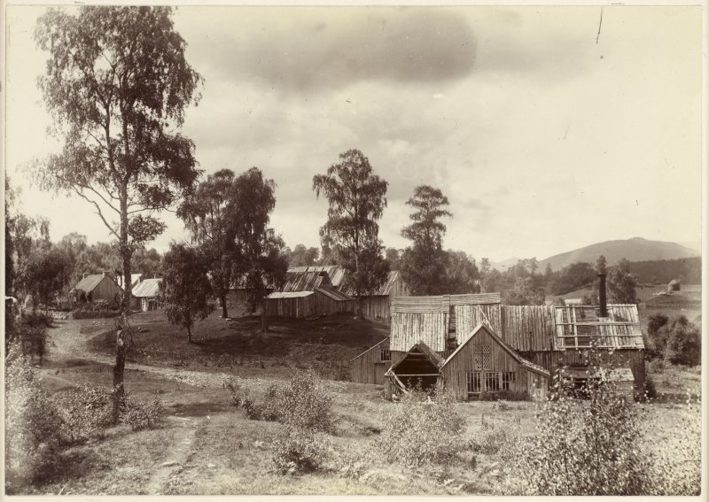 View of mill at Kinrara, near Aviemore, with slightly dilapidated wooden buildings.  Titled: 'Bobbin Mill /93'.