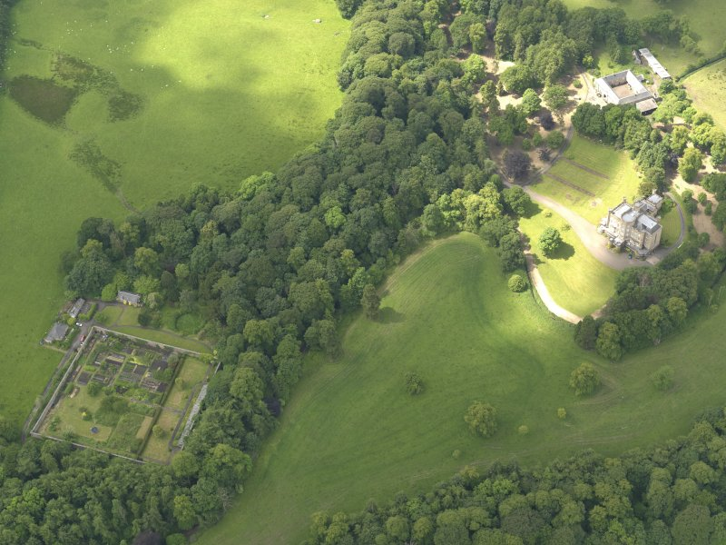 Oblique aerial view of Caprington Castle and policies, taken from the ENE.