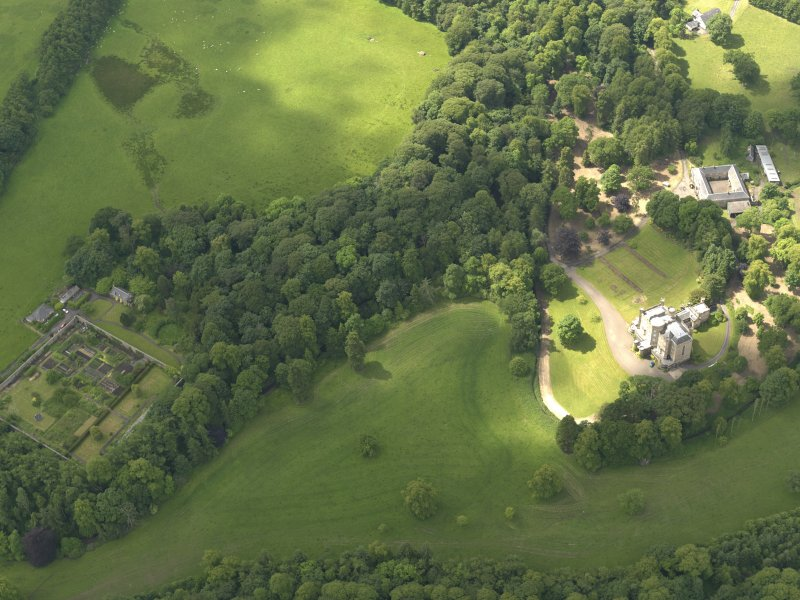 Oblique aerial view of Caprington Castle and policies, taken from the NE.