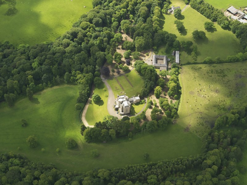 Oblique aerial view of Caprington Castle and stables, taken from the NNE.