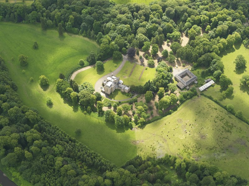 Oblique aerial view of Caprington Castle and stables, taken from the NNW.