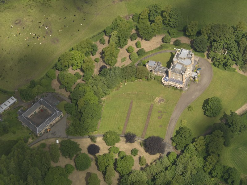 Oblique aerial view of Caprington Castle and stables, taken from the S.