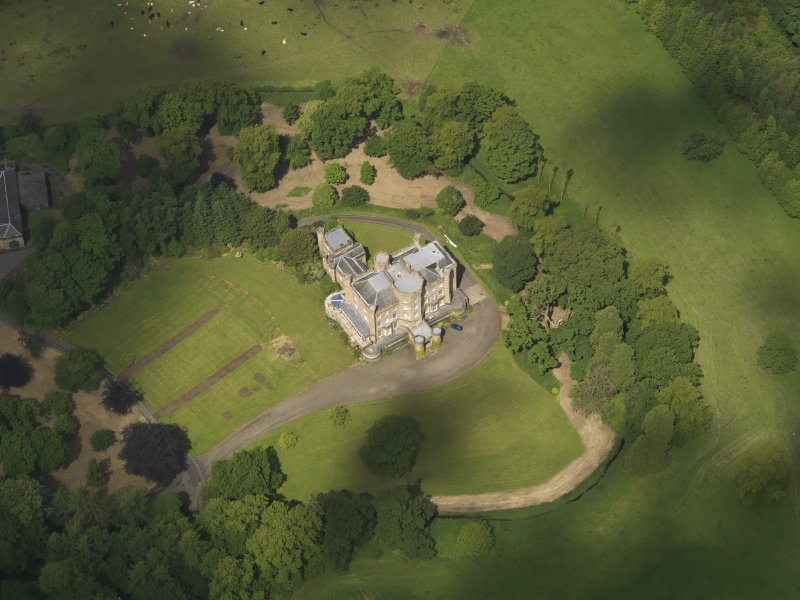 Oblique aerial view of Caprington Castle, taken from the SE.