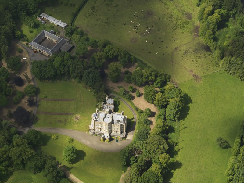 Oblique aerial view of Caprington Castle and stables, taken from the ESE.