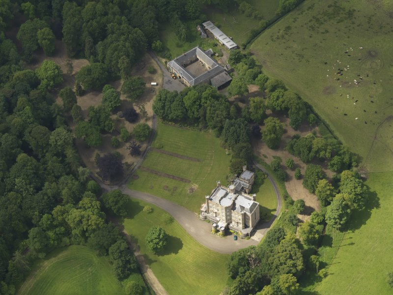Oblique aerial view of Caprington Castle and stables, taken from the E.
