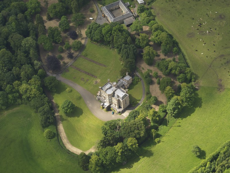 Oblique aerial view of Caprington Castle and stables, taken from the ENE.