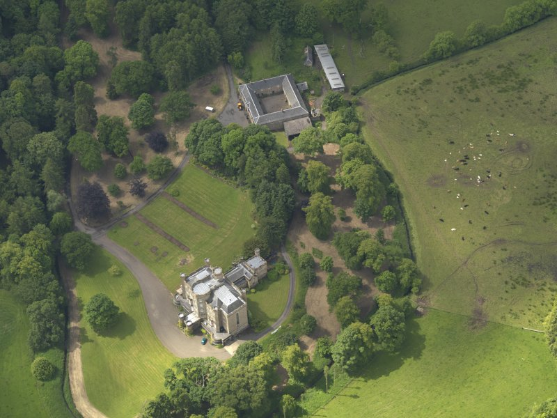 Oblique aerial view of Caprington Castle and stables, taken from the NE.