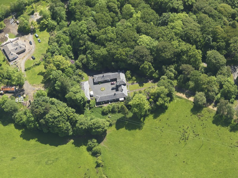 Oblique aerial view of Montgreenan Mains farmhouse, taken from the NW.