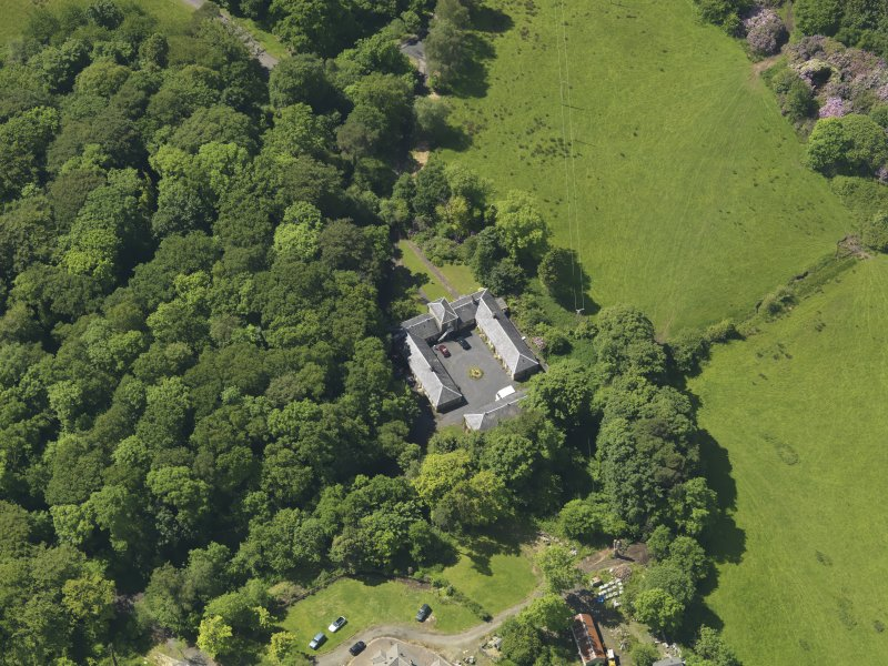 Oblique aerial view of Montgreenan Mains farmhouse, taken from the NE.
