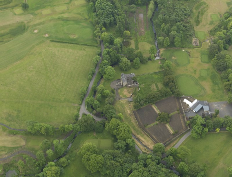 Oblique aerial view of Rowallan Castle and gardens, taken from the NE.