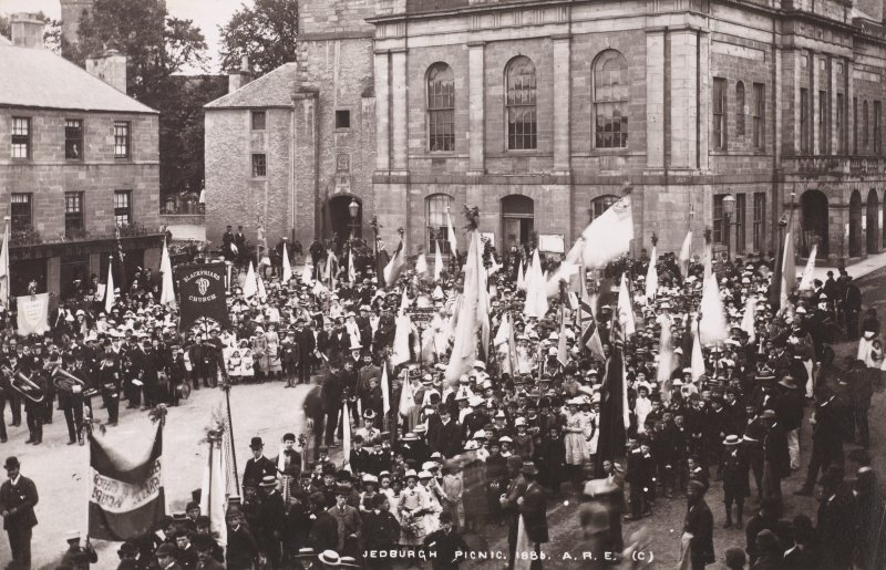 View of Abbey Place, Jedburgh with people gathered forcomunity picnic  Titled: 'Jedburgh Picnic. 1886. A.R.E.'