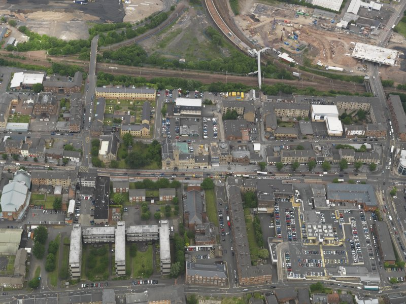 Oblique aerial view centred on Rutherglen High Street, taken from the S.