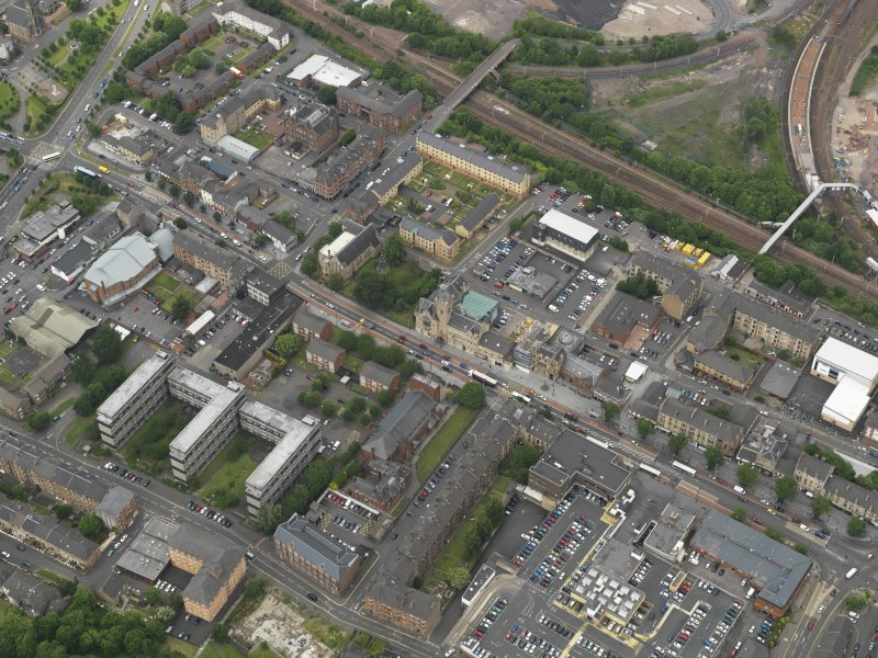 Oblique aerial view centred on Rutherglen High Street, taken from the SE.