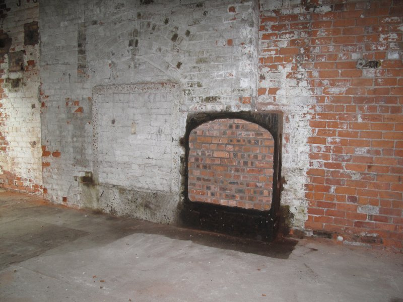 Interior. Building 14. Engine House for original No. 3 Paper Machine. Detail of fireplace on north wall.