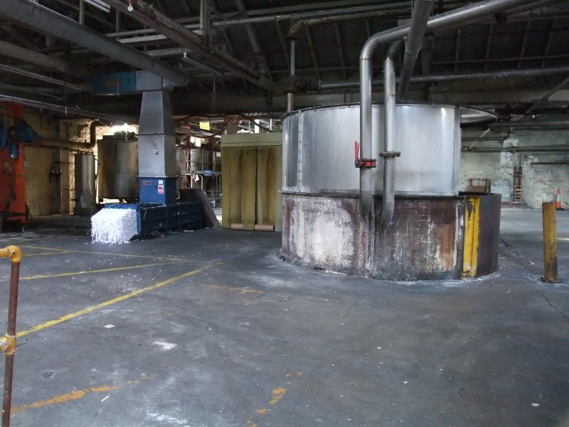 Interior, Building 4, Broke Bleaching and Broke Recovery. View from NE looking towards 12 feet width hydrapulper with baler (in blue) behind.