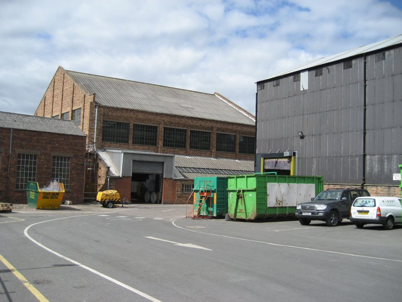General view looking SW. Building 6, former Calender House, latterly part of Finishing Department to left. This building contained stretch wrap machines, Jagenberg winders etc. Wood Pulp store (Building 1) to right of picture.