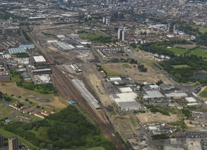 Oblique aerial view centred on the motive traction depot, taken from the SE.