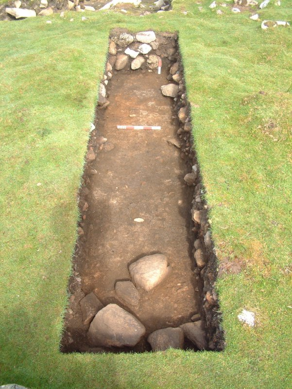 Trench 18 from the SE showing context C18.04 after removal of C18.03 (burnt mound material) - scales = 0.5m and 0.2m