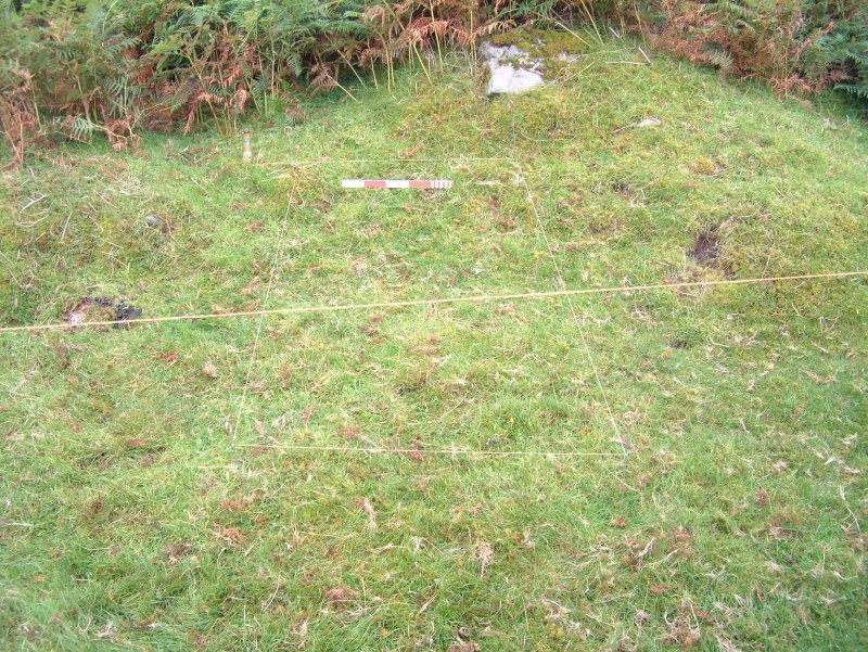 Location of Test Pit 3, in SE sector of site adjacent to grass platfrom and Trench 13 (scale = 0.5m)