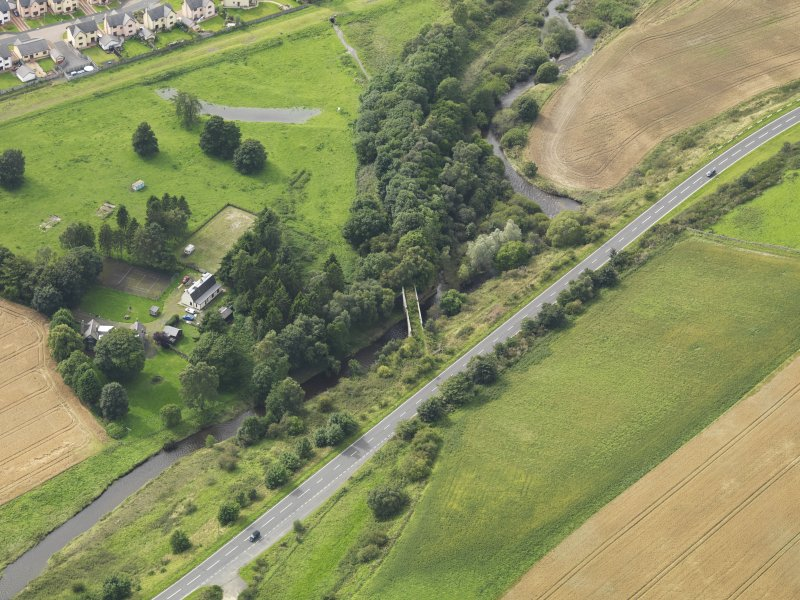 Oblique aerial view centred on the railway bridge, taken from the ENE.