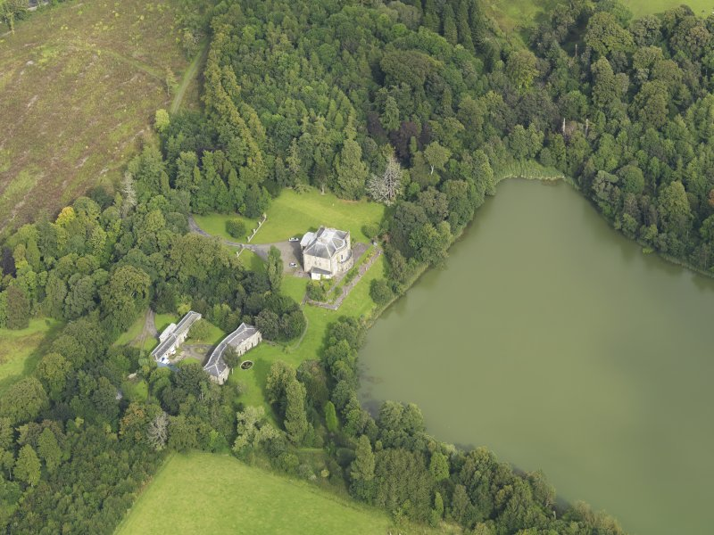 Oblique aerial view centred on the country house with the stable block adjacent, taken from the WSW.