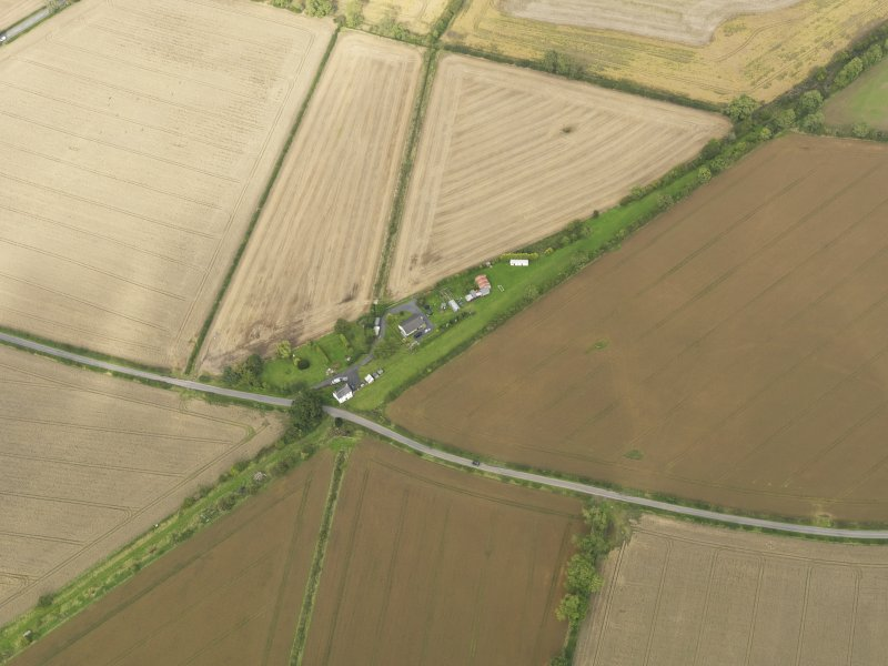 Oblique aerial view centred on the remains of the railway station, taken from the SW.